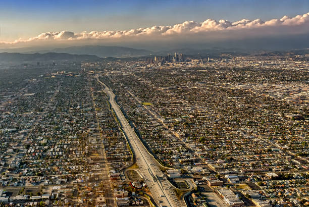 aerial view of los angeles city and freeway - urban sprawl stock photos and pictures