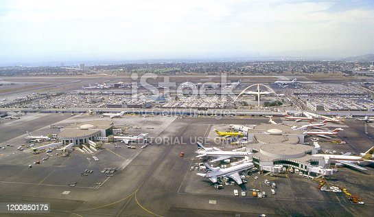Aerial view of Los Angeles International Airport (LAX) with the  Googie architectural style Theme Building right of center. Los Angeles, California, USA. June 1978. Scanned film.