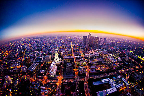 Aerial View of Los Angeles Skyline at Sunset Aerial view of Los Angeles Skyline at sunset from a helicopter fish eye lens stock pictures, royalty-free photos & images