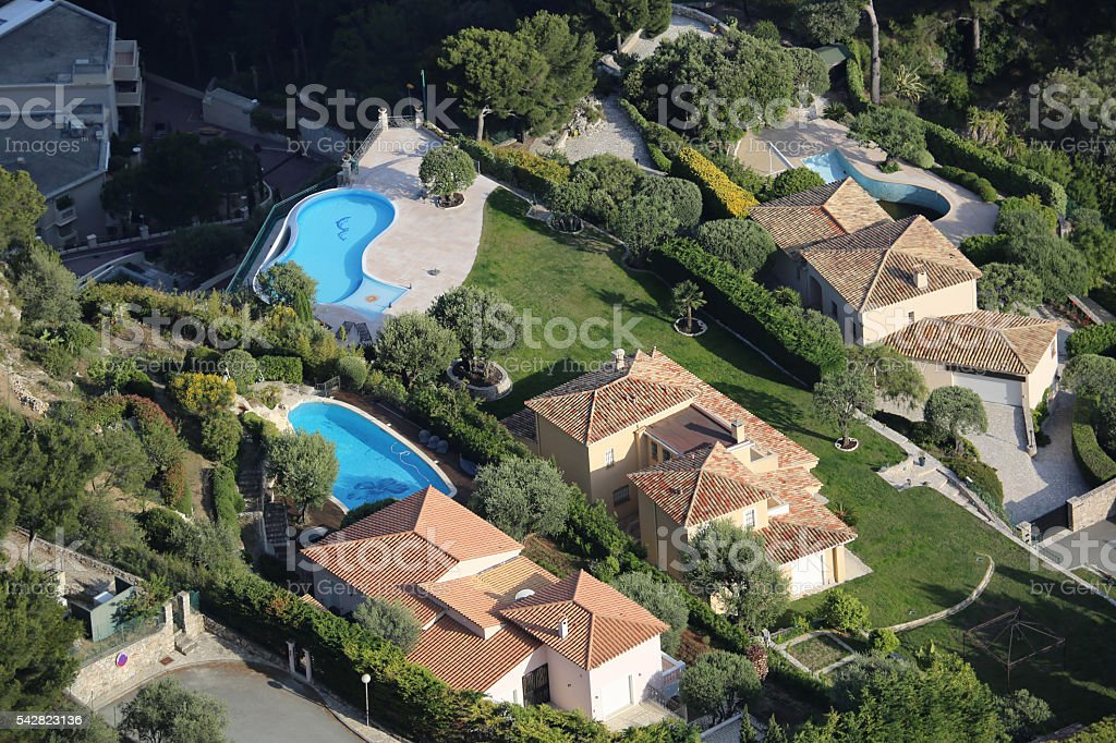 Aerial View of Luxurious Houses and Pools stock photo