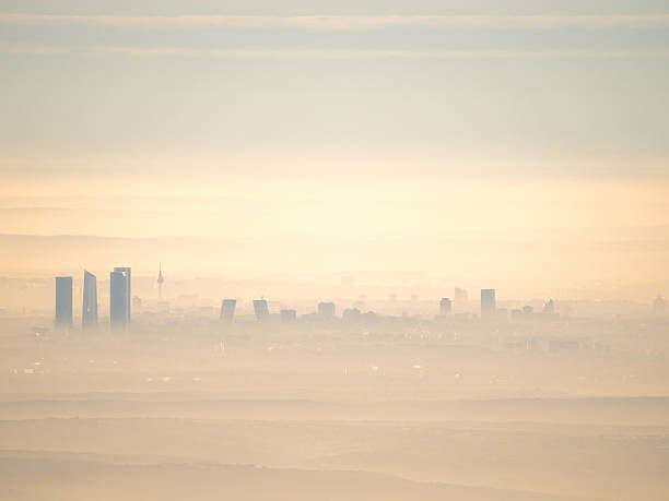 aerial view of madrid city with fog in the morning - pollution photos et images de collection