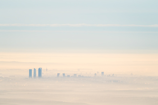 istock Aerial view of Madrid city with fog in the morning 628117148