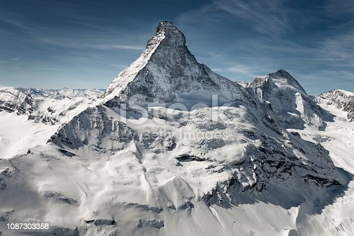 Aerial view of majestic and world famous Matterhorn mountain in front of a blue sky, Switzerland