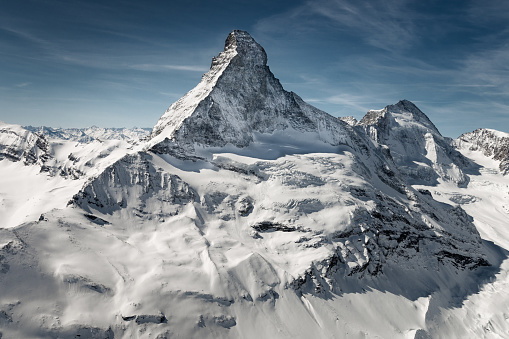 Aerial view of majestic Matterhorn mountain in front of a blue sky