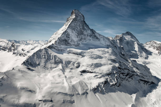 Aerial view of majestic Matterhorn mountain in front of a blue sky Aerial view of majestic and world famous Matterhorn mountain in front of a blue sky, Switzerland switzerland stock pictures, royalty-free photos & images