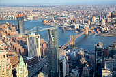 Aerial view of Lower Manhattan and Brooklyn with East River, Brooklyn Bridge and Manhattan Bridge, New York.