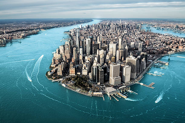 Aerial view of Manhattan island Helicopter point of view of Manhattan island in New York City. manhattan financial district stock pictures, royalty-free photos & images