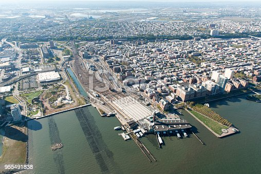Stunning aerial view of Hoboken, New Jersey, including the PATH station and the railyards from a helicopter.