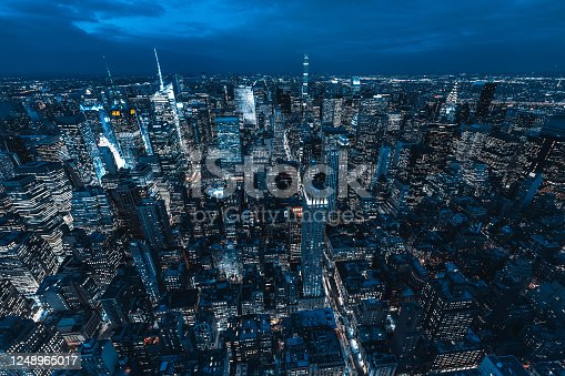 947373704 istock photo Aerial View of Manhattan Skyline and Skyscrapers at Night 1248965017