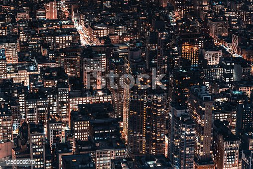 947373704 istock photo Aerial View of Manhattan Skyline and Skyscrapers at Night 1250909270