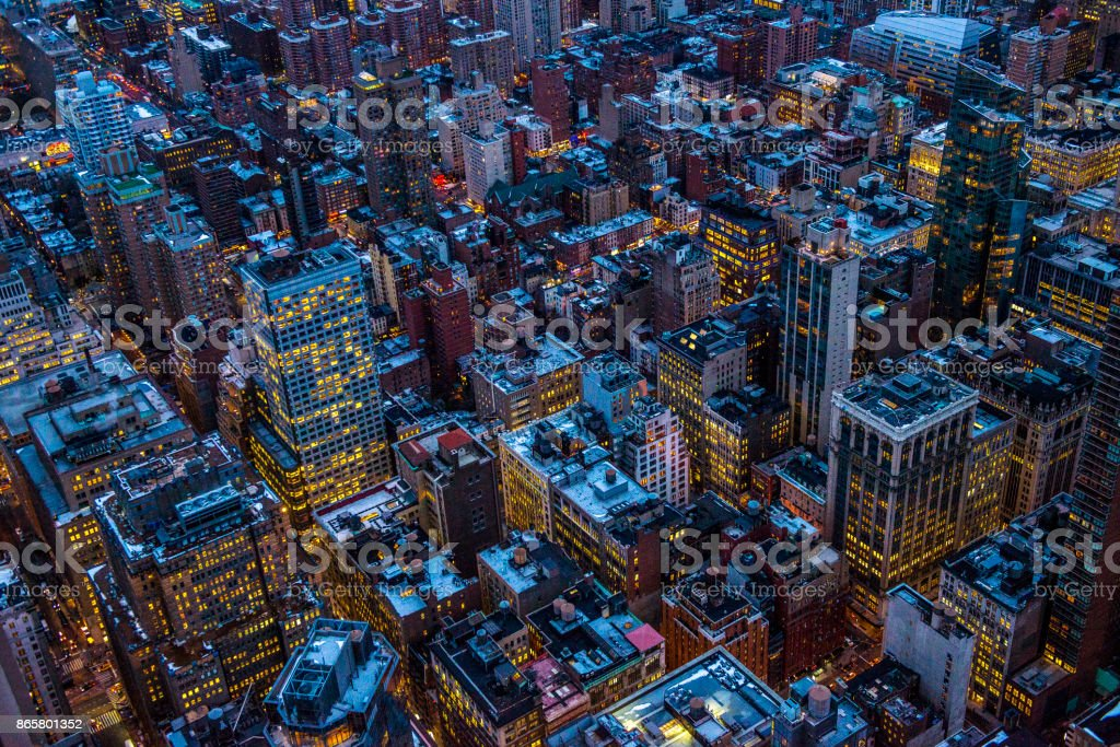 Aerial view of Manhattan skyline at dusk in New York City, NY, USA stock photo