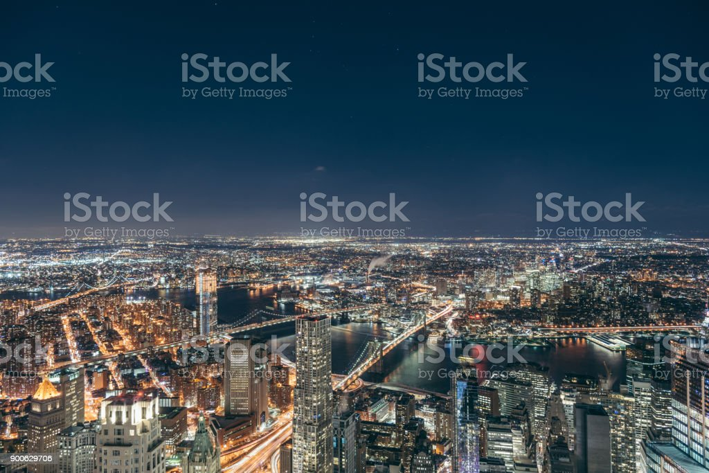 Aerial View of Manhattan Skyline at Night stock photo