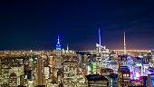 Aerial view of Manhattan skyline illuminated at night. New York, USA.