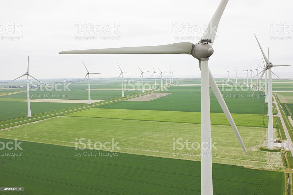 Aerial view of many turbines in a row stock photo