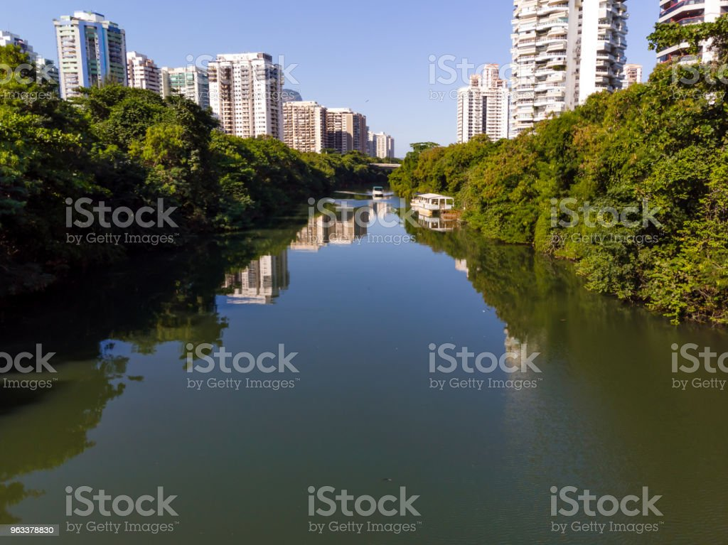 Aerial view of Marapendi canal in Barra da Tijuca on a summer day. Tall residential skyscrapers on both sides, with green vegetation - Zbiór zdjęć royalty-free (Architektura)