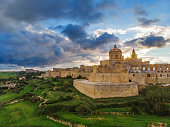 Aerial view of Mdina city - old capital of Malta country. Sunset time with  beautiful clouds and greeny