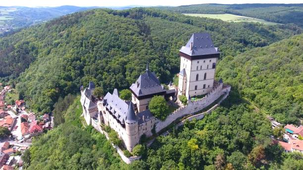 Aerial view of Medieval castle Karlstejn in Czech republic, Drone view Karlstejn, Czech Republic - August 14, 2017: Aerial view of Medieval castle Karlstejn in Czech republic, Europe, Drone view bohemia czech republic stock pictures, royalty-free photos & images