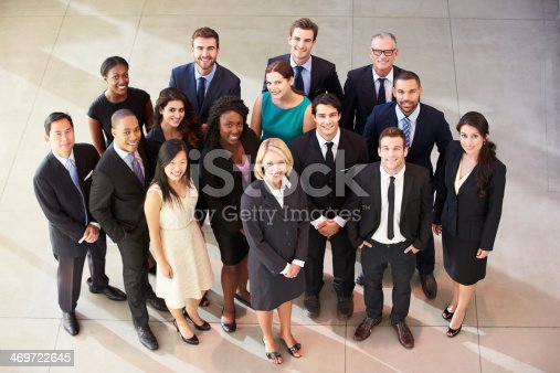 504879112istockphoto Aerial view of men and women in lobby 469722645
