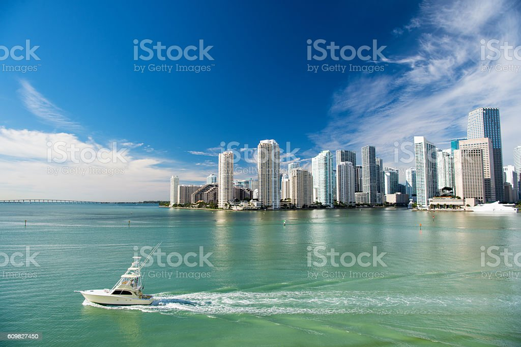 Aerial view of Miami skyscrapers with blue sky, boat sail stock photo