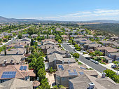 Aerial view of middle class residential villas with solar panel on the roof, San Diego County, California, USA.