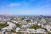 Lima, Peru - March 12 2019: Aerial view of Miraflores district including La Aurora parks. Clear and bright day, travel and destinations concept. Drone aerial shot of Lima's cityscape.