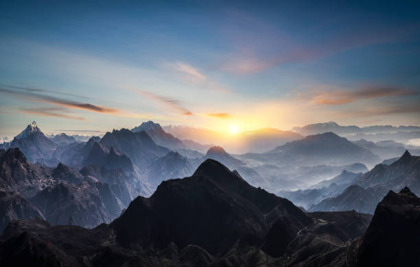 Aerial view of misty mountains at sunrise Aerial view of misty mountains at sunrise atmospheric mood stock pictures, royalty-free photos & images
