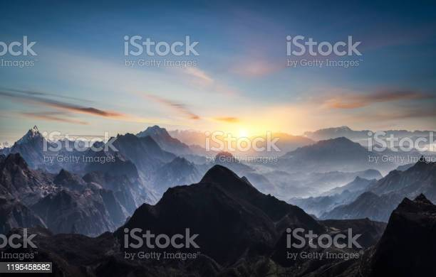 Photo of Aerial view of misty mountains at sunrise