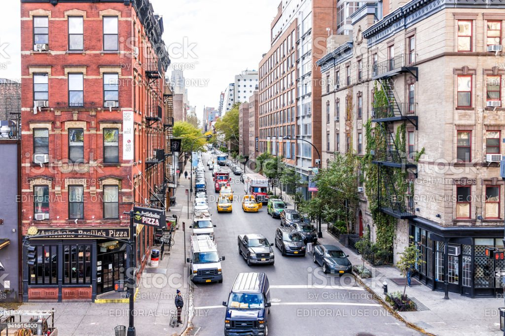 Aerial view of modern Chelsea neighborhood apartment buildings and cars in traffic on street below in New York, Manhattan, NYC stock photo