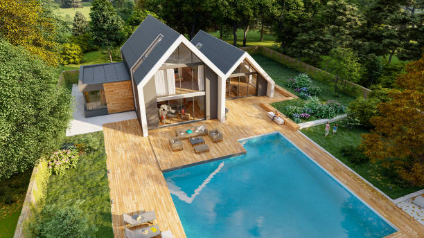 Aerial view of Modern pitched roof villa with pool and garden stock photo