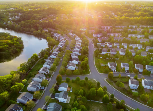 Aerial view of modern roofs of houses early sunrise Aerial view of modern roofs of houses of residential area summer houses early sunrise district stock pictures, royalty-free photos & images