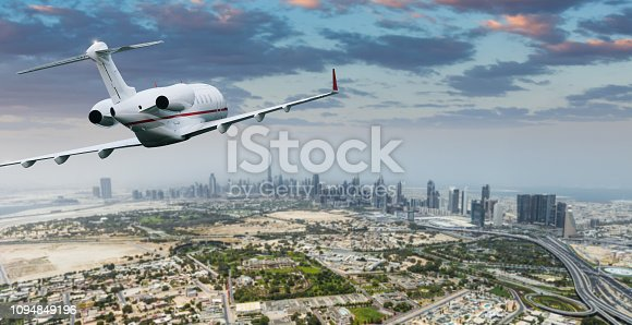 Aerial view with private jet of modern skyscrapers, Dubai, United Arab Emirates.