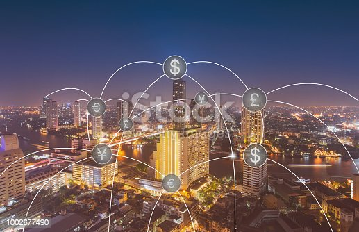 Aerial view of money transfer icon over cityscape for banking concept background.