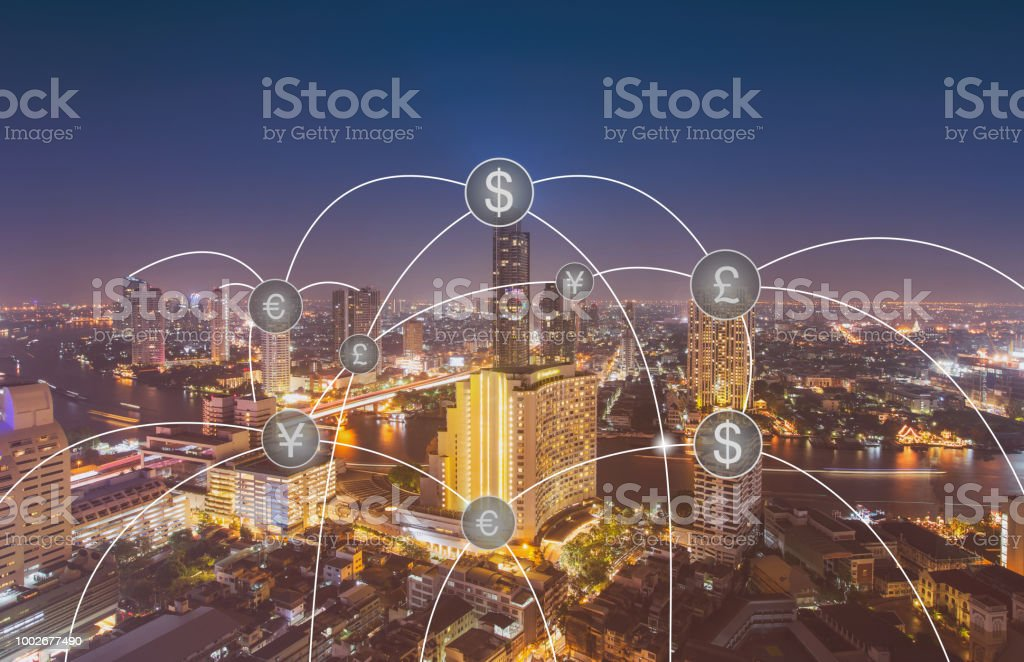Aerial view of money transfer icon over cityscape for banking concept background. stock photo