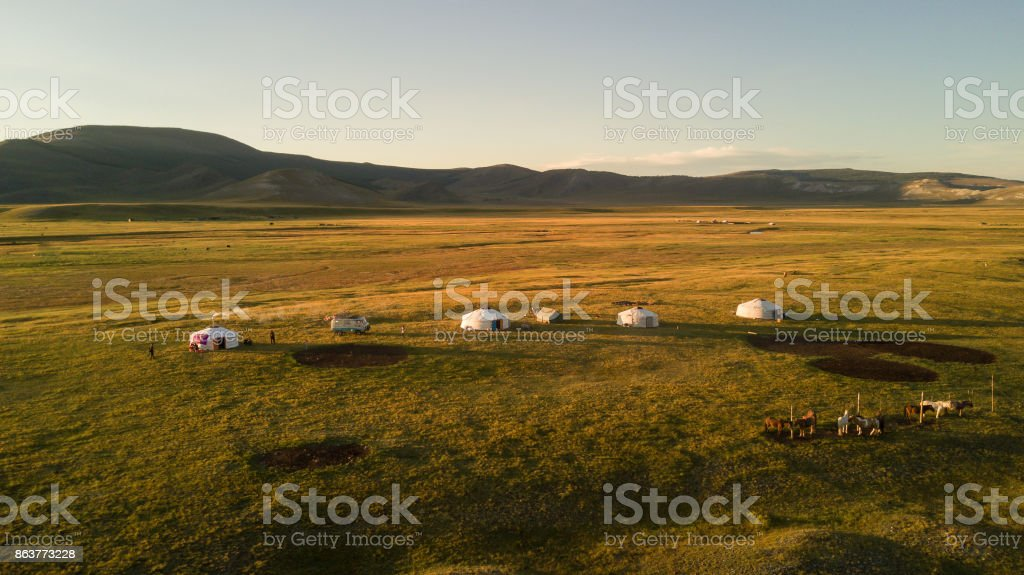 Aerial view of Mongolian ger community at sunset. stock photo