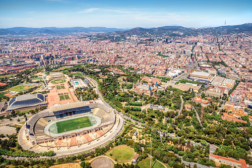 May 8, 2021 - Barcelona, Spain: Aerial view of the anella olimpica (olympic ring) and the Park of Montjuic in Montjuic mountain, and cityscape of Barcelona