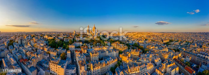 Aerial view of Montmartre hill with Basilique du Sacre-Coeur in Paris at sunset
