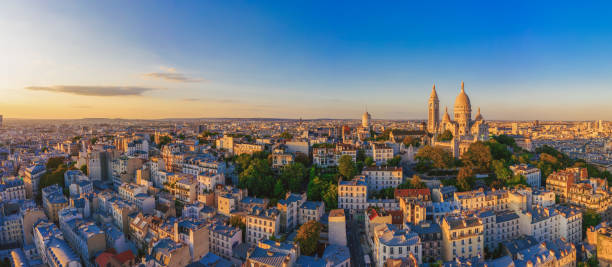 Aerial view of Montmartre hill with Basilique du Sacre-Coeur in Paris at sunset stock photo
