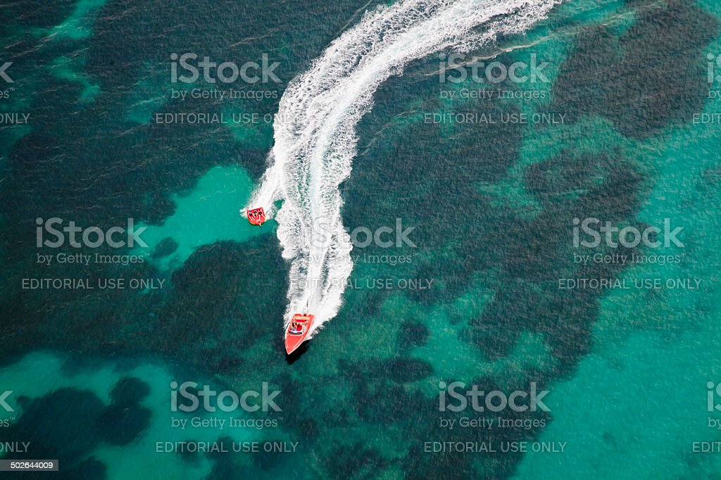 aerial view of motorboats making curves on the sea stock photo