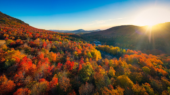 Aerial view of Mountain Forests with Brilliant Fall Colors in Autumn at Sunrise, Adirondacks, New York, New England