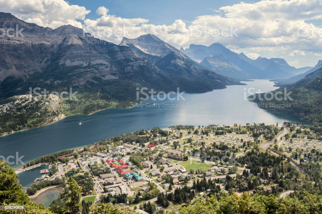 aerial view of mountains and lake and buildings stock photo