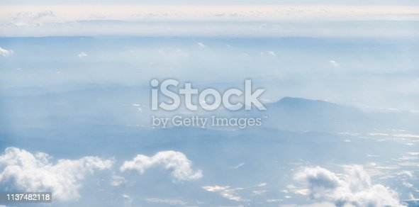 istock Aerial view of mountains in clouds 1137482118