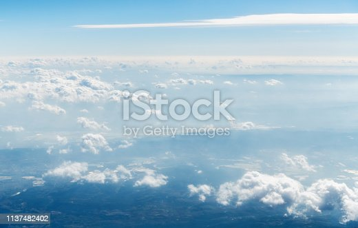 istock Aerial view of mountains in clouds 1137482402