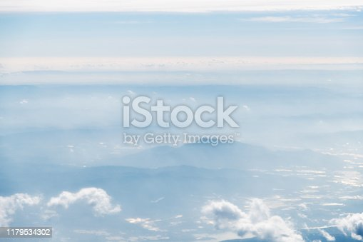 istock Aerial view of mountains in clouds 1179534302