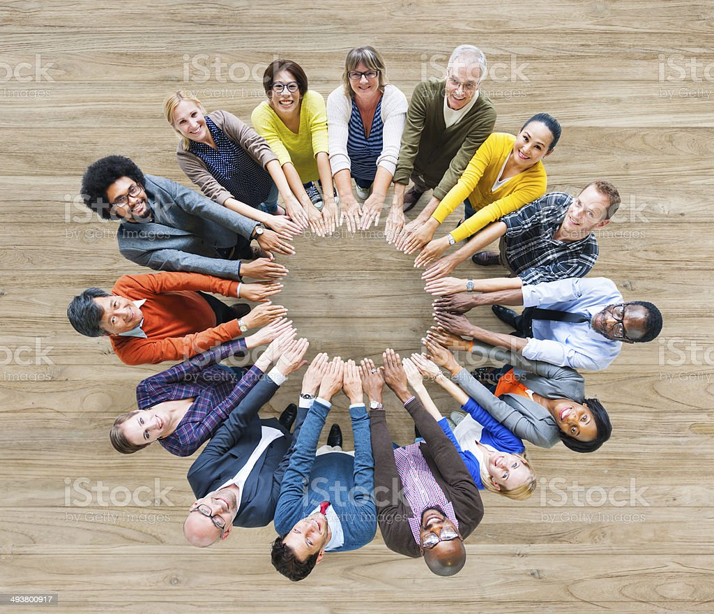 Aerial View of Multiethnic People Forming Circle of Hands stock photo