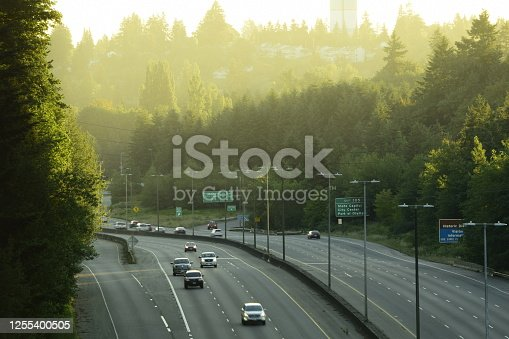 94502198 istock photo Aerial View Of Multi-Lane Highway And Vehicles During Morning Rush Against Sunrise 1255400505