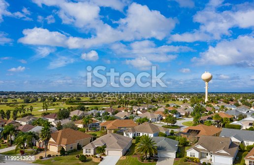 Drone view of residential neighborhood and golf course located in The Villages, a retirement and golfing community in Florida.