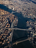 The three bridges that connect Brooklyn and Manhattan from an aerial view out of a window of an airplane preparing for landing. Williamsburg Bridge, Manhattan Bridge and Brooklyn Bridge.