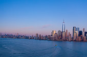istock Aerial view of New York city Manhattan skyline cityscape at dusk from New Jersey. 1211034306