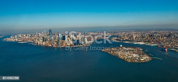 Aerial view of New York City skyline and Governors Island through helicopter. Horizontal composition. Helicopter moving Manhattan via Hudson river. Financial district appears fully in Lower Manhattan. Image taken with Nikon D800 and developed from Raw format.