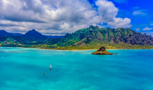 Aerial view of Oahu's coastline and Chinaman's Hat in Oahu Hawaii stock photo